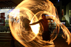Photo of fire dancer dancing on 5th fifth avenue ave playa del carmen mexico quintana roo