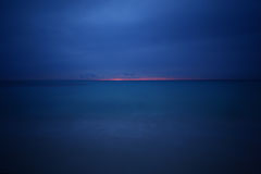 Photo of sunrise at playa del carmen mexico quintana roo beam of sunlight